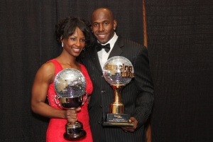 Betina Driver, and her husband and dancer partner Donald Driver, showing off their matching mirrorball trophies.