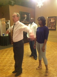 Terry teaching Betina and Donald a move for their rumba at his studio in Appleton.