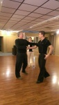 Michael helping Chris perfect his dance form.
