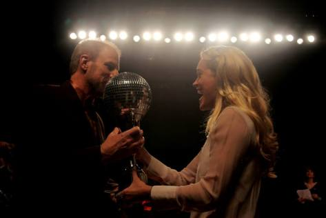 James Rivett receiving the Fundraising Mirrorball trophy from judge, Peta Murgatroyd