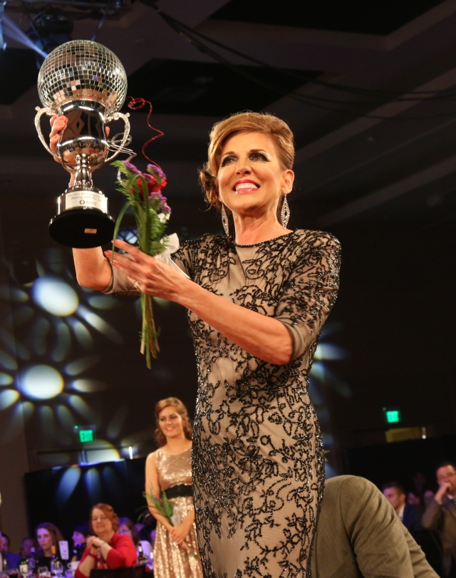 Karen Classon takes home the fundraising mirror ball trophy raising over $87,000. Photo by: Mark Witte